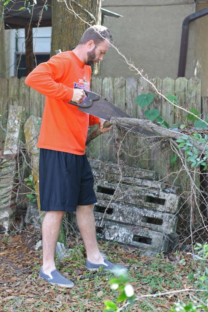 scott-cutting-wood-for-chicken-swing